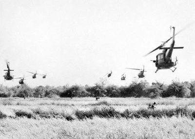 American Iroquois Helicopters Fly Over Australian Soldiers