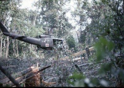 Huey Pilot Hovers While Loading Wounded Soldiers