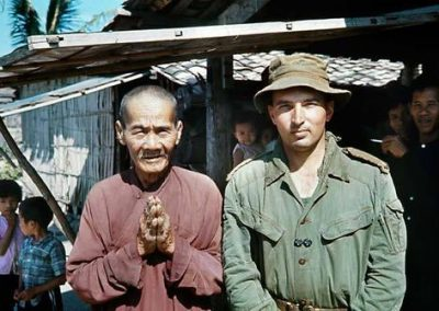 Local Villagers Surround Lieutenant John Lucaci and a Vietnamese Monk