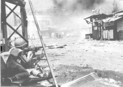Soldier Fires at Viet Cong Positions in Cholon During the Unsuccessful Tet Offensive