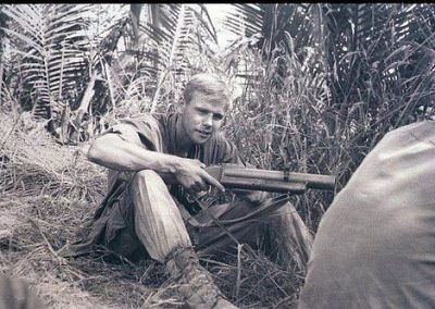 Soldier Holding Grenade Launcher on Patrol and Out in the Jungle