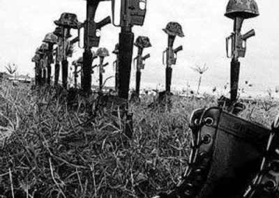 Soldier's Boots, Helmets, And Rifles Lined Up