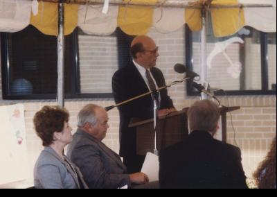 Eccles Lab School building dedication ceremony. Frank W. Budd (President 1991-2000) speaking.