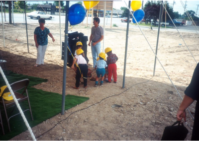 Children, dressed as construction workers, at the Eccles Lab School Ground Breaking