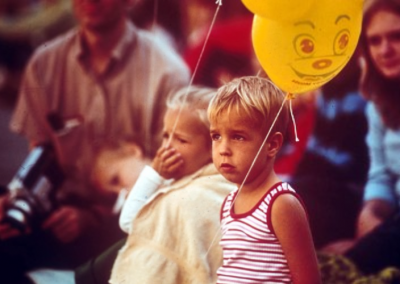 Children with balloons at the reception after the ground breaking for the new Eccles Lab School building.