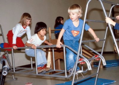 Children play on an indoor jungle gym at the Early Childhood Development School.