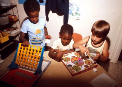 Children play with board games at Early Childhood Development Training.