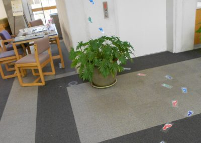 Colored little foot and hand prints on the floor and walls. Placed in order to guide visitors to different exhibits in the library.