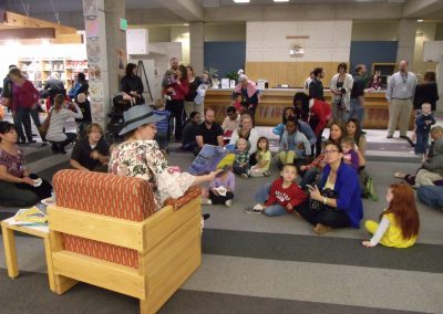 "Andrea Egbert reading ""Mother Goose"" to gathered children"