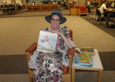 "Photo of Andrea Egbert or ""Mother Goose"" on this occasion. Shows the cover of ""Mother Goose Nursery Rhymes"""