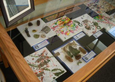 Display case of some of the children's art work, which they made in class at the Eccles Lab School.