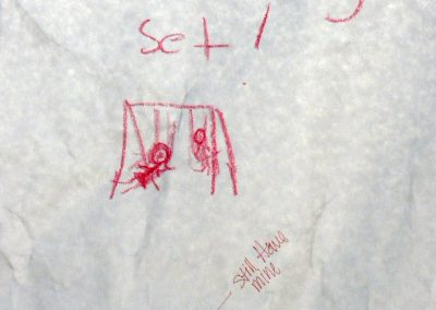 """Part of the Eccles Lab School installation in the Markosian Library. A sign asks for people to write something on butcher paper. Individuals could write about something they loved, learned or thought as a child. One close up says """"swing set!"""" another says """"Pokemon card collection"""""""