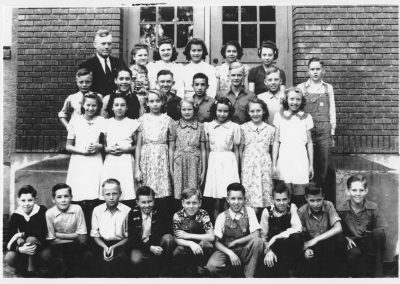 Newton Grade School, 7th-8th grade Class on the front steps of the Red Brick School.