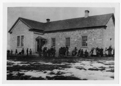 The rock school was the first public building in Newton, Utah. It was built on the east side of the town square. It measured 28x40 feet. This photograph was taken after an addition was built in 1892.