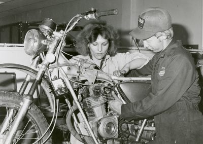 Student and instructor work on a motorcycle in auto-shop. Digitization completed with funds from a 2017 USHRAB (Utah State Historical Records Advisory Board) Grant that was awarded to Salt Lake Community College, Library Services. Photo likely taken between 1970-1986.