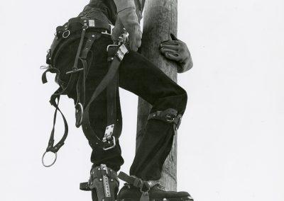 Student Electrician Climbs Practice Telephone Pole