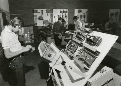 Student studying with electronics equipment in the Salt Lake Community College electronics lab. Digitization completed with funds from a 2017 USHRAB (Utah State Historical Records Advisory Board) Grant that was awarded to Salt Lake Community College, Library Services. Photo likely taken between 1975-1985.