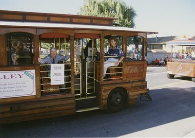 A trolley carrying Frank Layden, head coach of the Utah Starzz, and Norma Carr, Director of SLCC Athletics. Photo was taken September 9th, 1998.