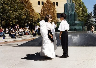 Two children, dressed for the occasion, dance in front of the O. C. Tanner fountain. The O. C. Tanner fountain has since been torn down. Photo was taken on September 20th, 2001.