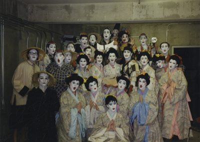 "Group portrait of the cast of ""The Mikado."" Photo likely taken between 1975 and 1995."