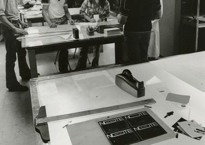 Students at light tables with printmaking emulsion taped to a light table. Photo likely taken between 1970 and 1980.