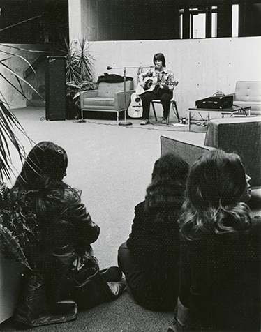 Guitarist plays for audience. Photo Likely taken between 1970 and 1980.