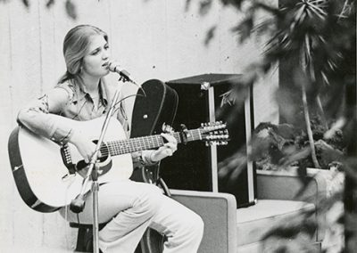 Live Music Performer playing in the College Center. Photo likely taken between 1970 and 1980.
