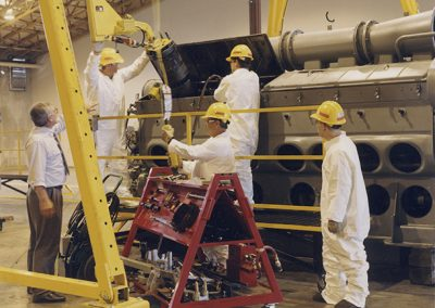 Student are pull assembly from an EMD (General Motors) 3000 horsepower 16 cylinder locomotive engine. Each cylinder has 645 cubic inches of displacement. Digitization completed with funds from a 2017 USHRAB (Utah State Historical Records Advisory Board) Grant that was awarded to Salt Lake Community College, Library Services. Photo likely taken between 1990-2000.