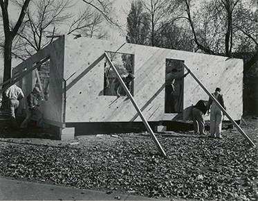 Early stage of student house building project with outside walls set up. Photo taken between 1954 and 1955.