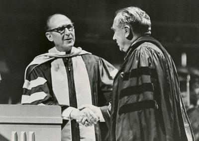 Governor Calvin L. Rampton delivered an address to the graduating class (shown Right). Following Calvin's address President Jay L. Nelson (shown Left) notified the Governor that a campus building had been named in his honor: The Calvin L. Rampton Technology Building. The graduation exercise was conducted in Highland High School in 1973.