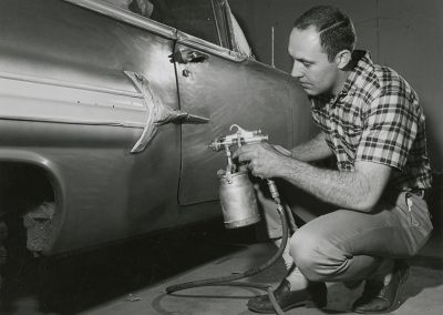 Student paints Chevrolet auto body. Digitization completed with funds from a 2017 USHRAB (Utah State Historical Records Advisory Board) Grant that was awarded to Salt Lake Community College, Library Services. Photo likely taken between 1960-1977.