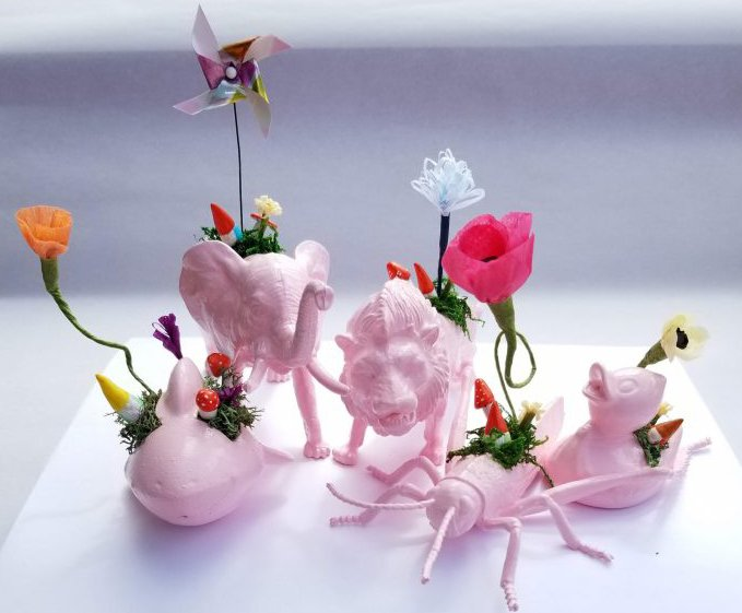 pink plastic animals with microgardens