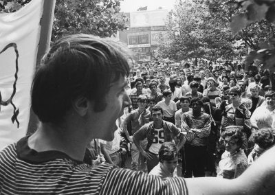 "A month after the Stonewall riots, a mass rally was held in New York City. Here, Marty Robinson of the Mattachine Society speaks to the assembled crowd. ""Gay power is here."""