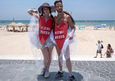 Image of a male and female couple during the Tel Aviv Pride celebrations.