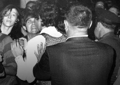 Image of the Stonewall Rioters getting pressed by the law enforcement officers, June 1969