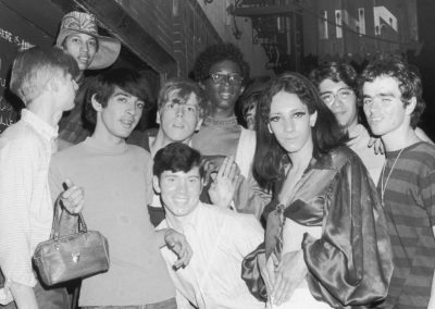 A group of young people – including Tommy Lanigan -Schmidt on the far right – celebrate outside the boarded-up Stonewall Inn after the riots.