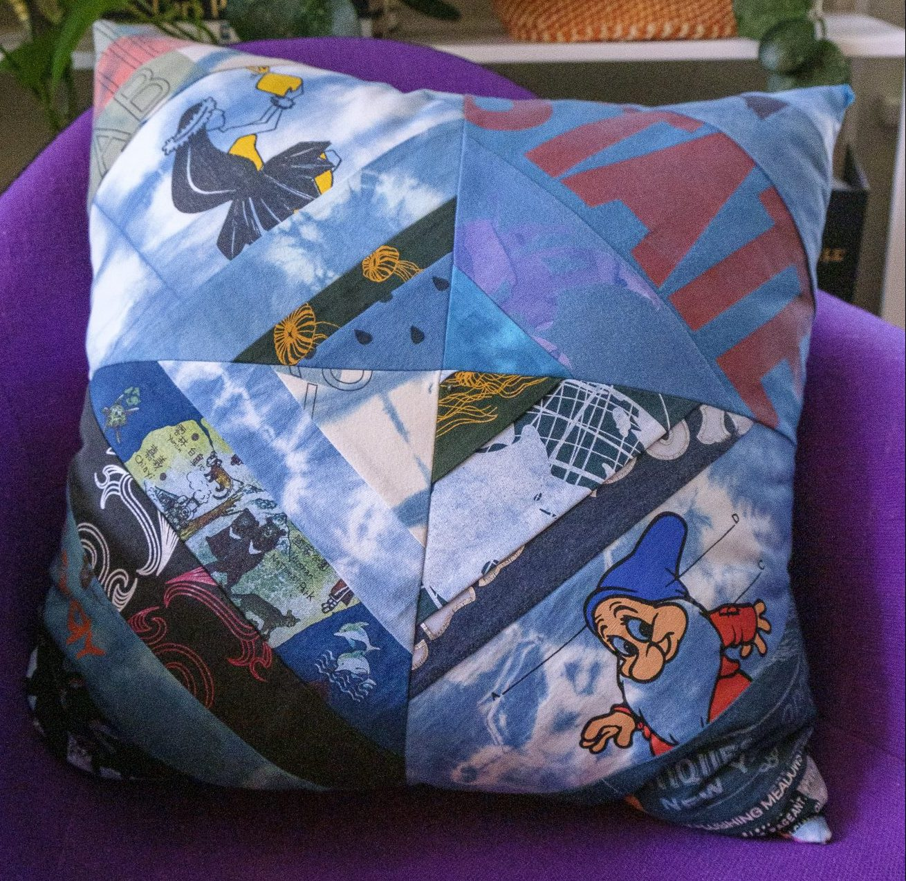 photo of upcycled pillow made from scraps of different fabrics